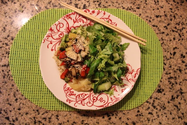 Arugula, frisee, mache and green tomato in miso maple vinegrette with Brown rice, stir fried veg and pickled ginger